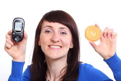 Smiling woman with glucometer and cake on white background Royalty Free Stock Image