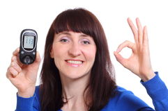 Smiling woman with glucose meter on white background Royalty Free Stock Photography