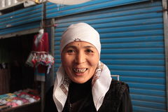 Smiling woman with gold teeth, Kyrgyzstan, Central Asia Royalty Free Stock Photo