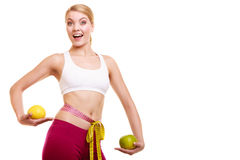 Smiling woman with grapefruits measuring tape. Royalty Free Stock Photos