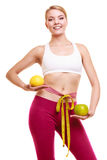 Smiling woman with grapefruits measuring tape. Royalty Free Stock Image