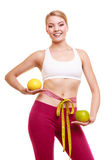 Smiling woman with grapefruits measuring tape. Stock Photography