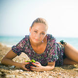 Smiling woman with grapes in the beach Stock Image