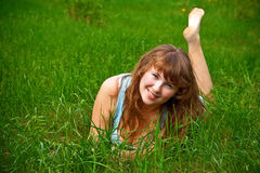 Smiling Woman On A Grass Royalty Free Stock Images