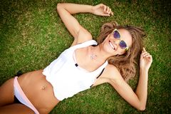 Smiling woman on the grass Royalty Free Stock Photo