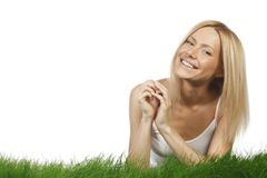 Smiling woman on grass Royalty Free Stock Photo