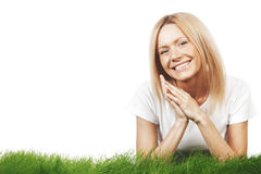 Smiling woman on grass Stock Images