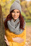 Smiling woman with a gray scarf and cap Royalty Free Stock Photography
