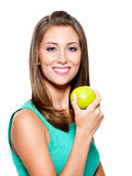 Smiling woman with green apple Stock Photography