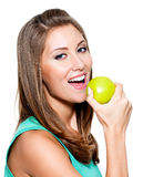 Smiling woman with green apple Stock Image
