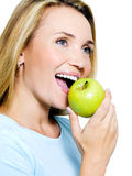 Smiling woman with green apple Stock Images