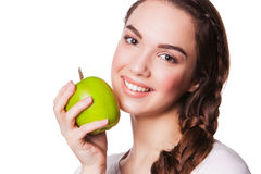 Smiling woman with Green Apple. isolated on white Royalty Free Stock Photo