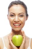 Smiling woman with green apple Royalty Free Stock Images