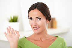 Smiling woman in green shirt looking at the camera Royalty Free Stock Images