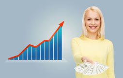 Smiling woman with growth chart and dollar money Stock Photography