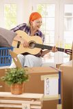 Smiling woman with guitar at moving Royalty Free Stock Image