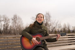 Smiling woman with a guitar Stock Photography