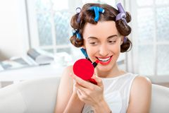 Smiling woman with hair curlers Royalty Free Stock Photography