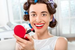 Smiling woman with hair curlers Royalty Free Stock Image