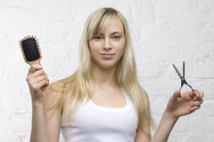 Smiling woman hairdresser with professional tools royalty free stock photos