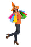 Smiling woman in Halloween hat with shopping bags Stock Image