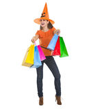 Smiling woman in Halloween hat with shopping bags Stock Images