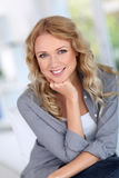 Smiling woman with hand on chin Royalty Free Stock Photos