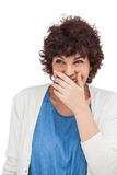 Smiling woman with hand on her mouth Royalty Free Stock Photo