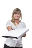 Smiling Woman is handing over a file Royalty Free Stock Photo