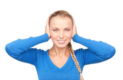 Smiling woman with hands over ears Stock Photography