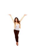 Smiling woman with hands up, isolated on white background Royalty Free Stock Images