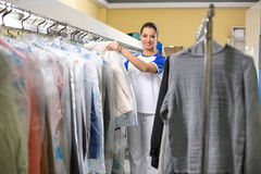 Smiling woman hanging clothes Stock Photos