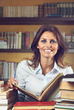 Smiling woman happy with books Royalty Free Stock Photos
