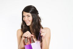 Smiling woman happy with her purchase Stock Photography