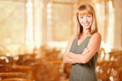 Smiling woman has crossed hands Stock Photography