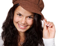 Smiling woman with hat. Young positive smiling woman wearing a brown hat isolated on white background Royalty Free Stock Photos