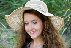 Smiling woman in hat royalty free stock photo