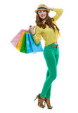 Smiling woman in hat with shopping bags on white background Royalty Free Stock Photography