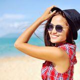 Smiling woman with hat and sunglasses in summertime Stock Image