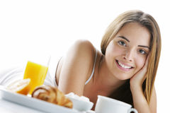 Smiling woman having breakfast Stock Images