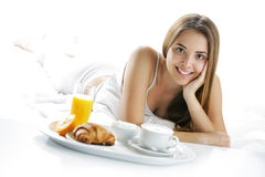 Smiling woman having breakfast Stock Photos
