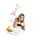 Smiling woman having breakfast Royalty Free Stock Images