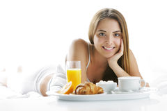 Smiling woman having breakfast Stock Photo