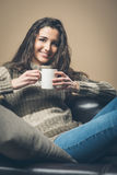 Smiling woman having a coffee Royalty Free Stock Photos