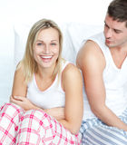 Smiling woman having fun with a man in bed Stock Photos