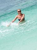 Smiling woman having fun playing in sea water Royalty Free Stock Photography