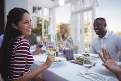 Smiling woman having wine during lunch Royalty Free Stock Photo