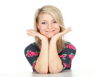 Smiling woman with head on hands Stock Photography