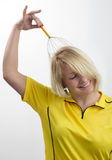 Smiling woman with a head massage tool Royalty Free Stock Photos