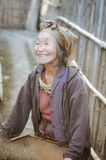 Smiling woman with headcloth in Arunachal Pradesh. Ziro, Arunachal Pradesh - circa March 2012: Photo of old smiling woman in blue jacket and with headcloth in Royalty Free Stock Photography